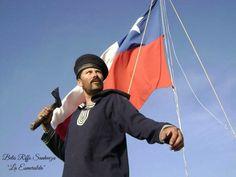 """Belis Riffo Sanhueza, recreando un marino de la Esmeralda durante el Combate Naval de Iquique, el 21 de Mayo de 1879. Por el hacha en su mano puede ser un soldado de la Artillería de  Marina, como lo fue el Sargento Juan de Dios Aldea, que murió en la gesta heróica de Iquique. Riffo, se destacó en la filmación de la película chilena """"La Esmeralda""""."""
