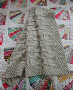 I love TRacey's baby afghan patterns - they are simple and elegant! Aran Crib Quilt Pattern  Moss and Basketweave by charliebear, $3.00