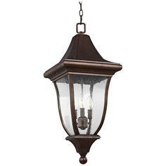 Feiss Oakmont Patina Bronze Traditional Clear Glass Lantern Pendant Light at Lowe's. The Feiss Oakmont three light outdoor pendant fixture in patina bronze creates a warm and inviting welcome presentation for your home's exterior. Outdoor Sconce Lighting, Lantern Pendant Lighting, Outdoor Hanging Lanterns, Outdoor Wall Lantern, Pendant Lights, Exterior Light Fixtures, Lantern Post, Curved Glass, 5 D