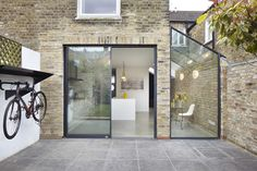 Rise Design Studio adds glass extension to London house Rise Design Studio has added a glazed extension to the rear of a London house, creating a light-filled kitchen and dining room that opens up to the garden House Extension Design, Glass Extension, Extension Designs, Side Extension, Extension Ideas, Exterior Design, Interior And Exterior, Exterior Tiles, Interior Walls