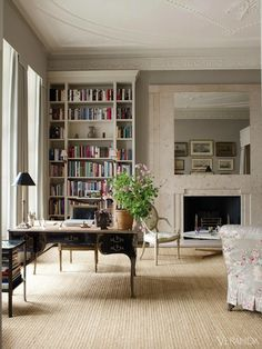 Neutral colors bring a distinct style and personality to this library. DESIGN BY VEERE GRENNEY Tour the entire home.    - Veranda.com