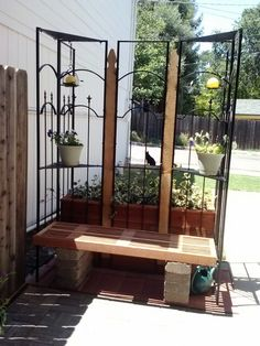 Recycled metal gazebo corners and fence pickets become a beatiful bench and trellis. From Rhonda Daugherty