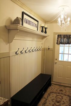 Mudroom bench and coat rack ... made to look built in.  Clever idea!