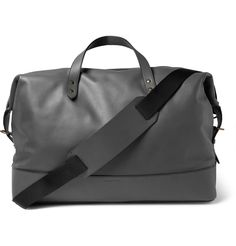 This minimalist grey holdall by <a href='http://www.mrporter.com/en-us/mens/designers/tomas_maier'>Tomas Maier</a> quietly exudes premium quality. Generously cut in Italy from supple leather and finished with sturdy top handles, it has a hardy canvas lining to ensure durability. The internal slip pockets, adjustable buckled sides and optional shoulder strap round out its practical appeal.