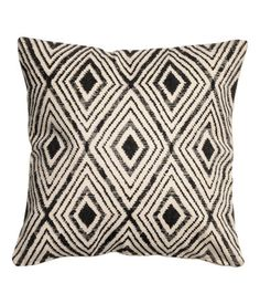 Natural white/charcoal gray. Cushion cover in thick, woven cotton fabric with a printed pattern at front and solid color at back. Concealed zip.