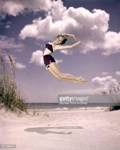 News Photo : A southern belle model leaps in the air on the...