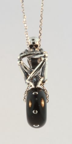 #SkeletonSpirit #Trollbeads converted into a necklace using a bead and a thin chain