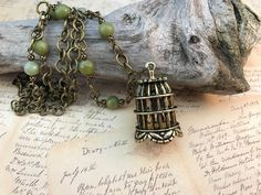 A personal favorite from my Etsy shop https://www.etsy.com/listing/475390041/birdcage-necklaceserpentineantique