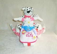 Custom Diaper Designs.  Take a look at our Custom Diaper Designs or Diaper Cakes!  Each design is completely made custom for your event!