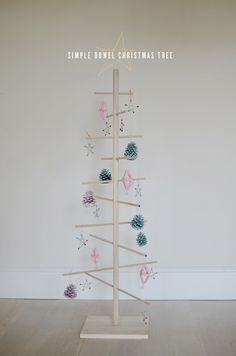 I REALLY want to make one of these, and rather then ornaments (Christmas stuff) put tiny clothes pins and hang the kids art material!