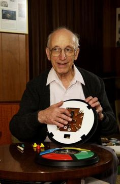 Ralph Baer,an iconic American inventor,with the game Simon