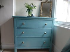 Ikea chest of drawers that I painted in Annie Sloan Provence with Greek Blue inside the drawers. The knobs are from Anthropologie