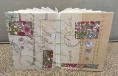 Front and back covers of a Coptic bound handstitched book Embroidery Hoops, Hand Stitching, Gift Wrapping, Book, Gifts, Gift Wrapping Paper, Presents, Wrapping Gifts, Books