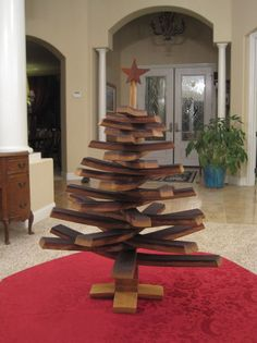 Wine Barrel Christmas Tree.... this would be awesome on a nice porch with basic white lights.