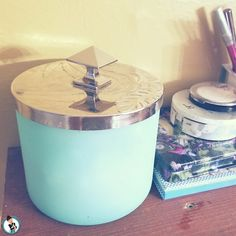 10 Ways To Declutter Right Now Candle Jar Reuse. Candle Jar Made Into A Cool Cotton Pad And Cotton Swab Storage Container. Cotton Swab, Cotton Pads, Reuse Candle Jars, Clutter Free Home, Storage Containers, Declutter, Candles, Storage Bins, Organizing Life