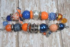 Cute!      Blue and Orange- Beaded Interchangeable Watch Band. $18.00, via Etsy.