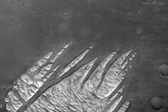 White Rock Fingers on Mars - What caused this unusual light rock formation on Mars? Intrigued by the possibility that they could be salt deposits left over as an ancient lakebed dried-up detailed studies of these fingers now indicate a more mundane possibility: volcanic ash. Studying the exact color of the formation indicated the possible volcanic origin. The light material appears to have eroded away from surrounding area indicating a very low-density substance. The stark contrast between…