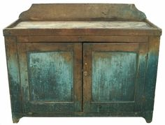 """19th century Pennslyvnia Drysink with original wonderful worn dry  blue paint, with two panel doors which are mortised and pegged, naturial patina interior, solid board ends with a cut out foot, dovetaile well. circa 1820  48 1/2"""" wide x 21 1/2"""" deep x 38 1/4"""" tall. From Country Treasures Antiques"""
