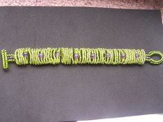 Green with Amethyst Bracelet 100% beads