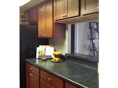 Modern kitchen with dark wood finishes. Detroit City Apartments, luxury apartment living in the Central Business District of Detroit.