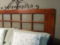 Ive seen people use old doors as headboards before and I always really liked the look.  I decided to try it with a french door because it was free and it happened to be exactly the size of a king size bed.
