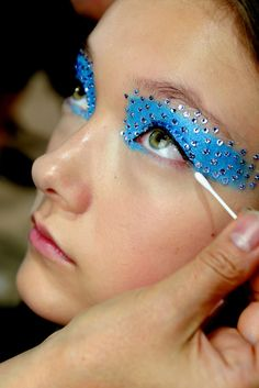 carnival makeup catwalkqueens:  Yumi Lambert backstage at Christian Dior Spring 2013    A little Lichtenstein, a little peacock, certainly not for the office.