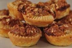 Pecan Tassies are miniature pecan pies with lovely golden brown crusts and sweet and gooey pecan filling. From Joyofbaking.com With Demo Video