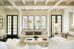 Gray window and doors Windows and doors are by Marvin brand aluminum clad with wood interior The windows in this picture have a darker sash and smaller divided lite bars to recall the look of a steel window