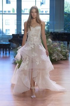 See more wedding dresses from Monique Lhuillier Bridal Fall 2017.