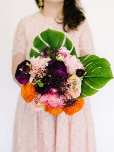 These are the best fake flowers that look real for weddings! Loving this peony and leaf bouquet for spring wedding that has violet, millennial pink, orange and green for colors.  This tutorial shows you how to make your fake flowers look real and gives several DIY tips to create perfect (but fake) bouquets.