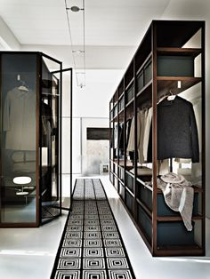 this is one of the most handsome closet I have ever seen- clean, distinct lines, dark wood against white, this is a true dream closet space