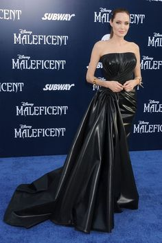 [b]The Dress:[/b] An Atelier Versace high-shine strapless gown.  [b]The Occasion:[/b] The World Premiere Of Disney's [i]Maleficent[/i] at the El Capitan Theatre on May 28, 2014 in Hollywood, California.  [b]The Wow Factor:[/b] 6/10: A lot of wow, but we're not sure this is our favourite look from the star.