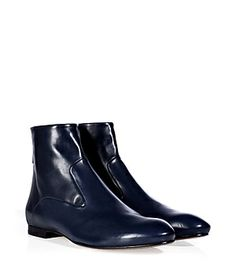 Detailed in immaculately soft navy calfskin, Jil Sander's back zip ankle boots lends a sophisticated, streamlined finish to any outfit #Stylebop