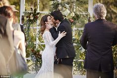 Wedding bliss! Leah and Zac seal their marriage with a kiss...