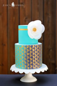 Blue and gold cake with wafer paper flower - Jessica Harris