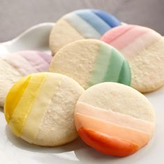 Ombre Candy-Dipped Cookies - The trendsetting ombre look comes to cookies! Create various shades of your favorite colors of Candy Melts