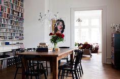 white walls, walnut table, ebony chairs.