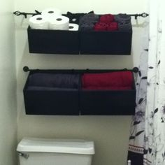 Hanging baskets on shower curtain rods attatched to the wall by command hooks to hold various bathroom stuff