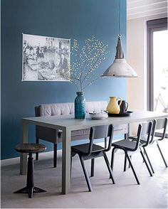 Like the mix of the chairs and bench with the table. Like the soft colors...