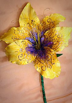 Handmade Rapunzel Flower from Tangled that Glows by KoalaBlu2u want to make my own for rapunzel's bouquet