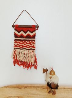 Mercury is a handmade tapestry woven on a frame loom using both Navajo and European weaving techniques. This weaving is made of 100% wool yarn from