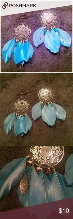 Silver Feathered Dreamcatcher Earrings Perfect for any occasion. Never been used. In perfect condition. Feel free to ask questions. Reasonable offers considered. No trades. icing Jewelry Earrings
