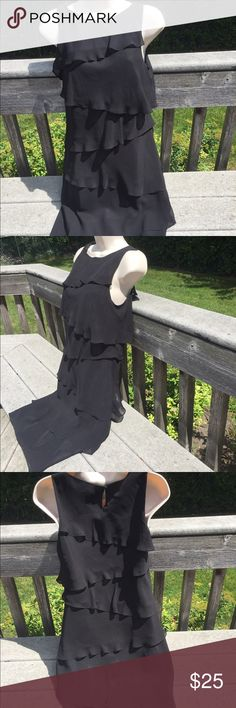 "Lightweight Black Dress 100% polyester. Very light   Length is 39""  under the arms across laying flat is almost 19"" Chaps Dresses"