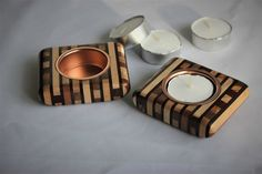 A beautiful pair of strip wood (laminated together in sequence) tealight holders. Very tactile with their rounded edges, almost like pebbles. Using woods like maple, rosewood, walnut, mahogany and olive wood. They come as a pair and both have metal ins. Strip Wood, Have Metal, Wood Laminate, Tea Light Holder, Tea Lights, Wood Crafts, Woodworking Crafts, Wood Creations