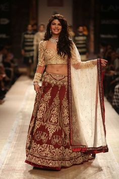 Jaqueline Fernandez in traditional maroon and gold Indian wedding lehnga by Anju Modi at Lakme Fashion Week Winter 2014. More here: http://www.indianweddingsite.com/lakme-fashion-week-winter-2014-anju-modi-collection/