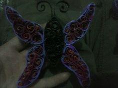 Mariposa de papel reciclado