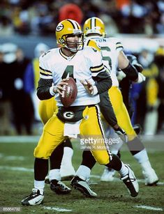 f03df962a3e Green Bay Packers quarterback Brett Favre looks for an open receiver during  the Packers 2017 overtime