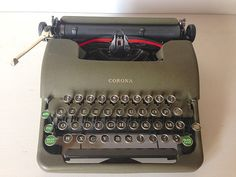 Antique Corona Manual Typewriter With Case Green Floating Shift Mechanism Portable Typewriter (432)  A classic! manual Corona Standard typewriter dating from the 30s This Typewriter in lovely shape, it has such a nostalgic look to it. It has a dark green matte finish to it. This matte finish was was introduced to reduce the glares from a traditional glossy finish. Green is also more difficult to find than the traditional black finish. It has what I think are referred to as the classic glass…