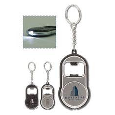 LT90951 Sleutelhanger.  Handige sleutelhanger van plastic, met flesopener en lampje. Lampje te bedienen door schuifknopje. Inclusief batterijen...