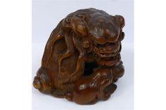 Edo/Meiji Period Japanese Netsuke, intricately carved box wood netsuke depicting a crouching Shi-Shi and cub